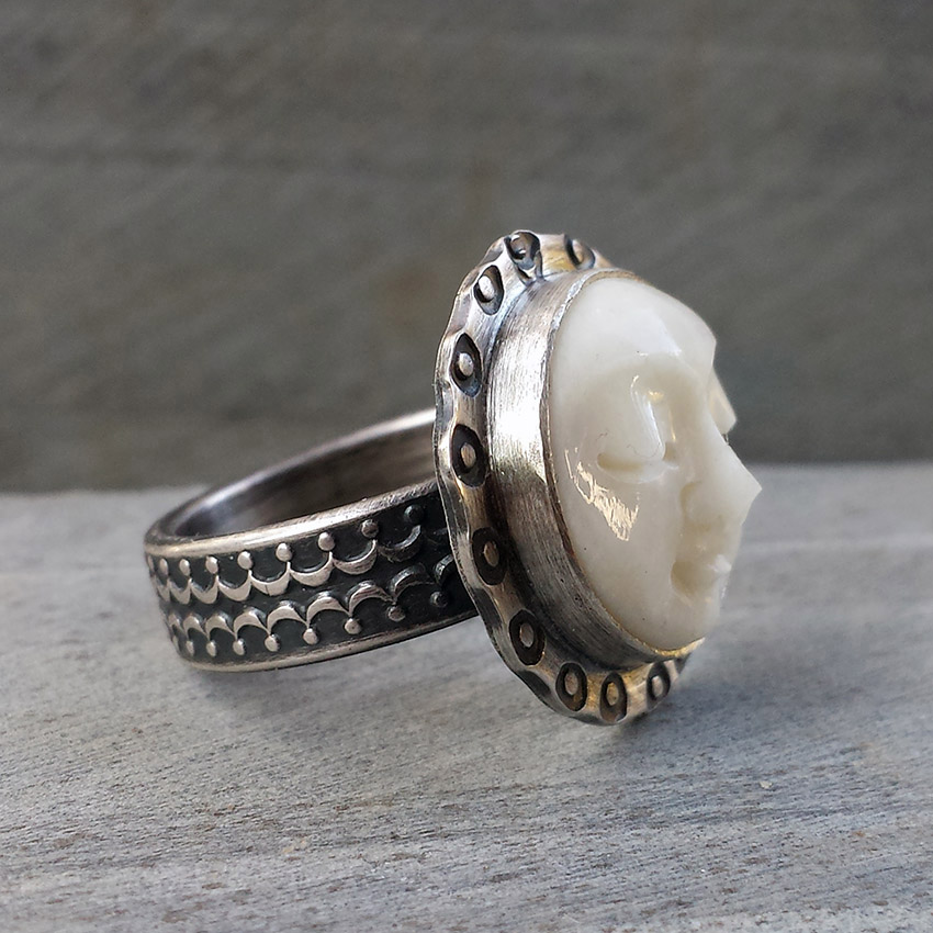 g-carved moon ring